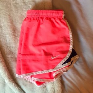 Neon pink and purple nike shorts